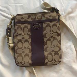 Across the shoulder coach bag